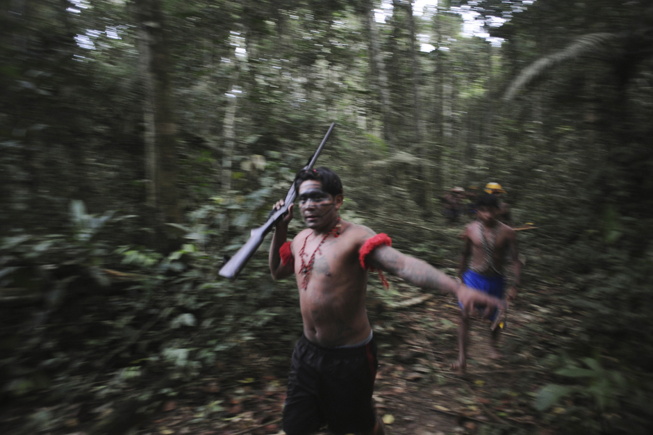 Munduruku Indian warriors search for illegal gold mines and miners in their territory near the Das Tropas river in western Para state