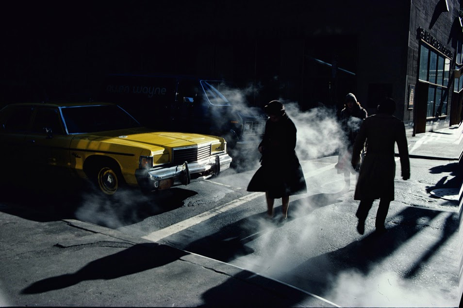 Ernst HaasvGetty Images. Pedestrians crossing a New York street in winter time cast long shadows, 1980.