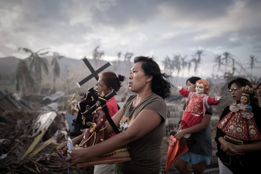 last-november-typhoon-haiyan-destroyed-large-parts-of-the-philippines-leaving-more-than-4-million-homeless-and-killing-more-than-8000-people-here-survivors-march-during-a-religious-procession