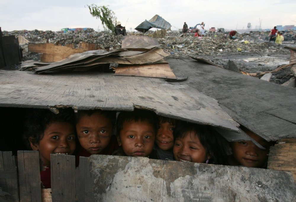 these-children-have-made-a-makeshift-playhouse-out-of-materials-they-found-at-this-dump-site-where-they-live-in-manila-philippines