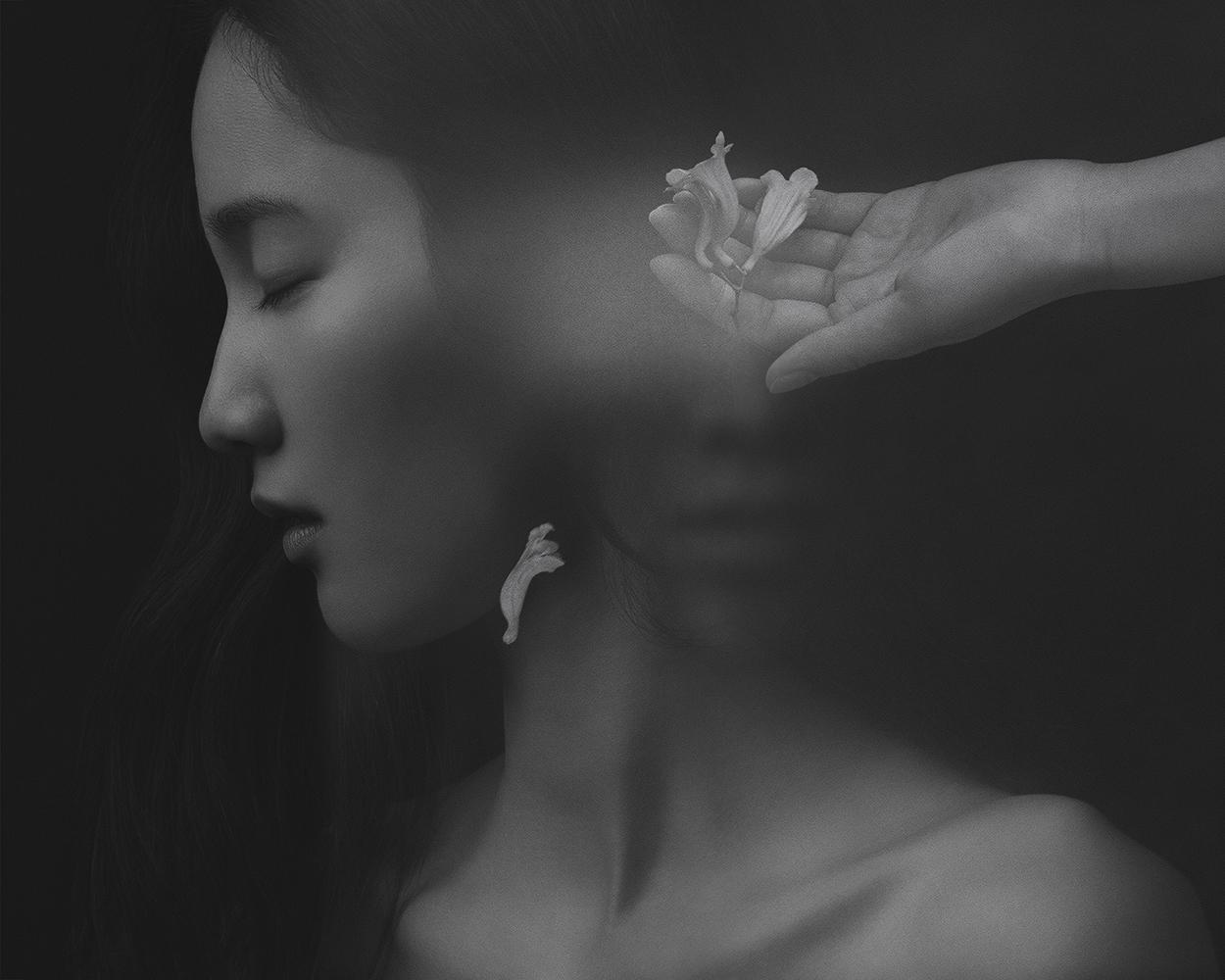 Suxing Zhang